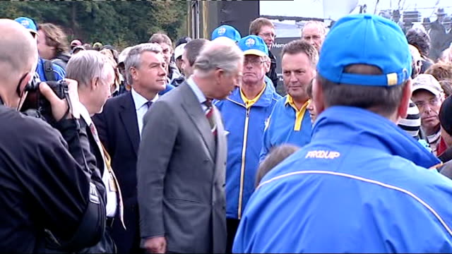 prince charles visits ryder cup venue; charles along in golf buggy and waving / charles getting out of golf buggy and shaking hands / charles along... - putting green stock videos & royalty-free footage