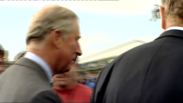 prince charles visits ryder cup venue wales newport celtic manor golf resort ext prince charles prince of wales and others arriving on golf buggies /... - pga event stock videos and b-roll footage