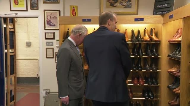 vídeos y material grabado en eventos de stock de prince charles visits shoe manufacturers tricker's, watches shoes being made, unveils plaque; england: northamptonshire: northampton: tricker's int... - northamptonshire