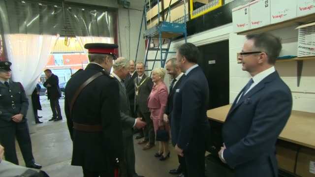prince charles visits shoemakers gaziano and girling signs visitors book and presented with pair of shoes england northamptonshire kettering... - shoes in a row stock videos & royalty-free footage