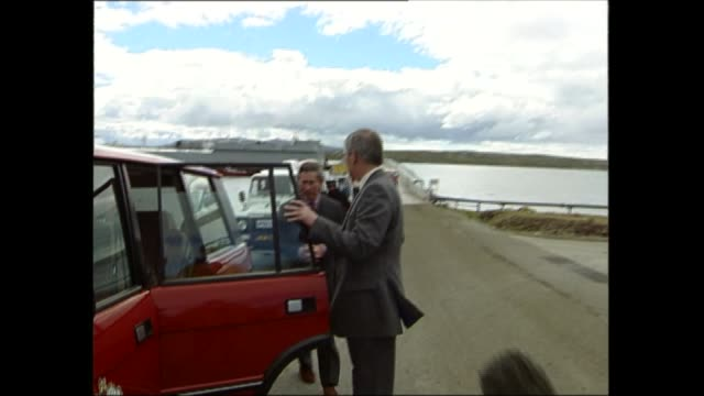 prince charles visits the falkland islands falkland islands / las malvinas ext gv lighthouse as prince charles prince of wales out and along to range... - isole dell'oceano atlantico video stock e b–roll