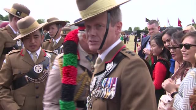 prince charles visits the royal gurkha rifles; england: kent: folkestone: ext pipers playing as prince charles, prince of wales and others on stage... - signierstunde stock-videos und b-roll-filmmaterial