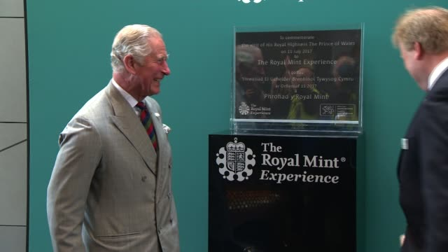 prince charles visits the royal mint in llantrisant wales llantrisant the royal mint photography*** prince charles prince of wales signing the... - royal mint stock videos & royalty-free footage