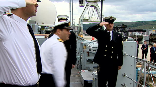 Prince Charles visits the Royal Navy base on the Clyde SCOTLAND Clyde Bangor moored / Union flag / HMS Bangor banner on walkway / Prince Charles...