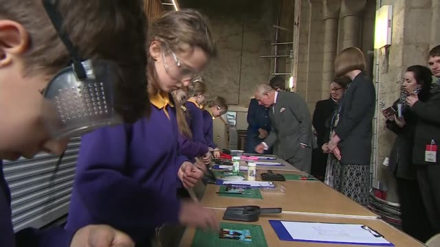 Prince Charles visits Thomas Parsons' Square and Ely Cathedral ENGLAND Cambridgshire Ely Ely Cathedral INT Schoolchildren making stained glass /...