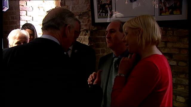 prince charles visits tottenham; england: london: tottenham: int ** beware flash photography throughout ** prince charles and camilla, duchess of... - 女子ボクシング点の映像素材/bロール