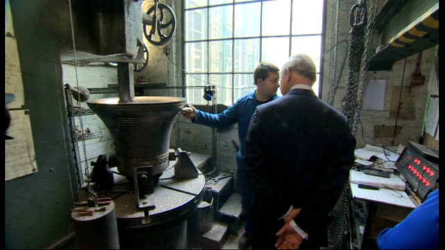 prince charles visits whitechapel bell foundry; charles chatting to bell workers / charles signs visitors' book / charles chats to worker who tests... - engraved image stock videos & royalty-free footage