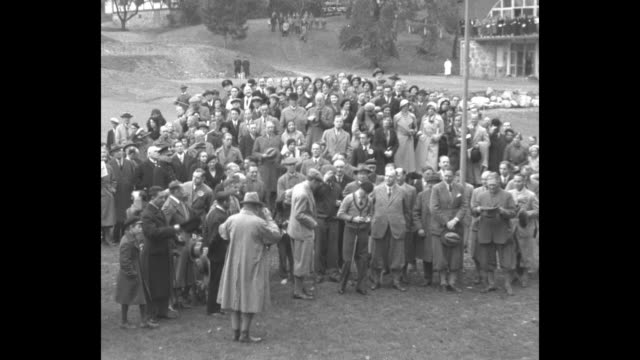 stockvideo's en b-roll-footage met ms prince edward and prince gustaf adolf watching unseen player tee off applauding / ls prince edward placing golf ball on tee backing up taking... - 1930