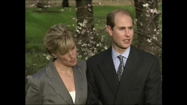 prince edward and sophie rhys-jones engagement photocall; england: london: st james's palace: ext gv prince edward & sophie along & stop in front of... - prince edward, earl of wessex stock videos & royalty-free footage