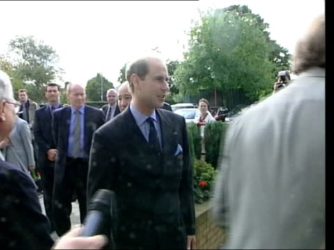 Prince Edward to stop making Royal programmes LIB London EXT Edward Earl of Wessex along past as speaking to press SCOTLAND St Andrews Prince Charles...