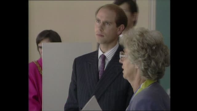 prince edward visits 'anne frank in the world' exhibition; england: cambridge: ext: gvs people waiting on pavement for prince edward to arrive gv... - prince edward, earl of wessex stock videos & royalty-free footage