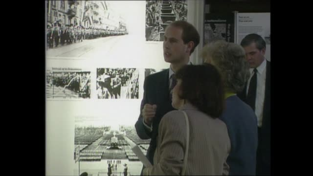 prince edward visits 'anne frank in the world' exhibition; england: cambridge: int various shots prince edward along as looking at photographs while... - earl of wessex stock videos & royalty-free footage