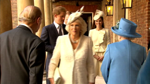 Prince George christened at St James's Palace Arrivals GVs Queen's convoy along and through the Tudor Gate of St James's Palace / Sound of baby...