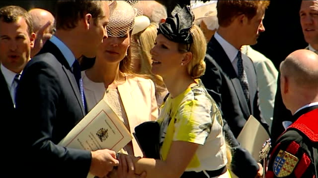Prince George christened at St James's Palace R04061307 / William and Kate chattingto Zara Tindall