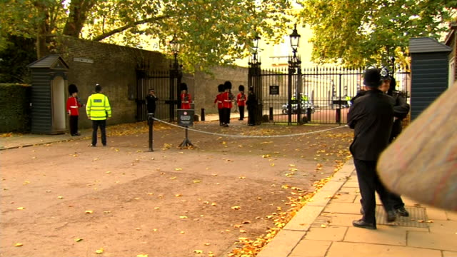 Prince George christened at St James's Palace Vehicles arriving and departing London DAY Entrance to St James's Palace as various vehicles departing...