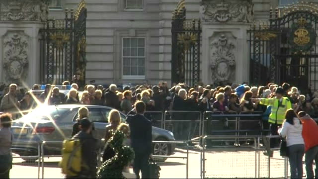 Queen leaves Buckingham Palace ENGLAND London Crowds outside Buckingham Palace / Car with Queen Elizabeth II along