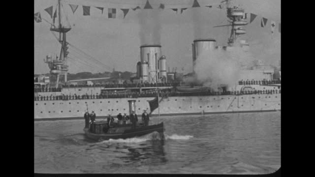 prince gets off british battleship renown and boards motor launch / launch comes towards shore battleship in background / cu prince in naval uniform... - 1910 1919 stock videos and b-roll footage