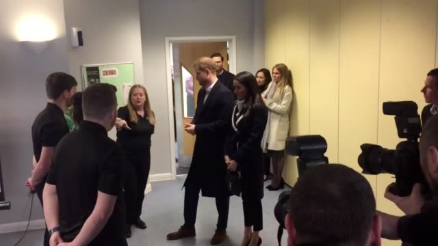Prince Harry and fiance Meghan Markle meet Coach Core aprentices at the Nechells Wellbeing Centre in Birmingham The apprenticeship scheme designed by...