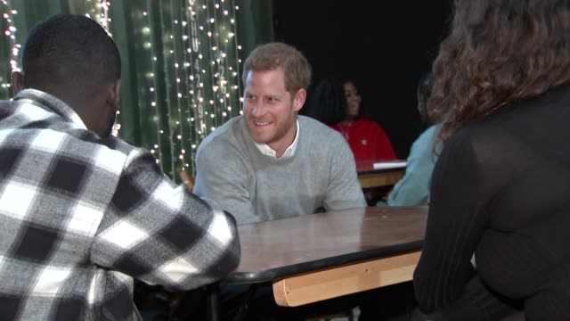 prince harry and fiancée meghan markle visit brixton reprezent fm visit prince harry and meghan markle into room and talking to people / various of... - fiancé stock videos and b-roll footage