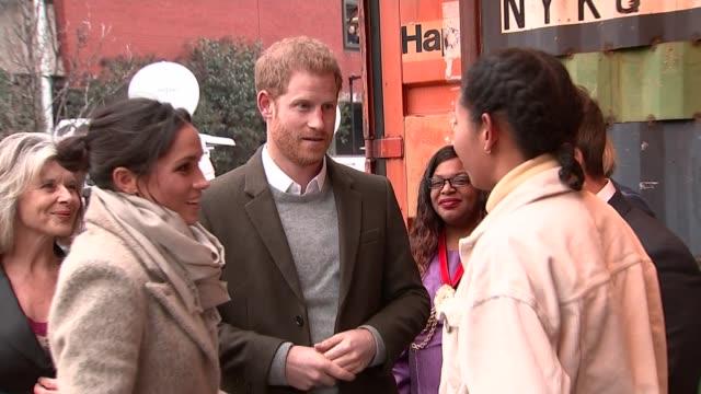 Prince Harry and fiancée Meghan Markle visit Brixton Reprezent FM visit ****SOME London Brixton EXT Placard displayed by crowd 'Harry Megan Brixton...