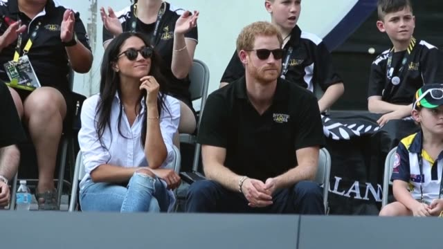 prince harry and girlfriend meghan markle attend the tennis event at the invictus games at nathan phillips square in toronto on monday september 25... - prince harry stock videos & royalty-free footage