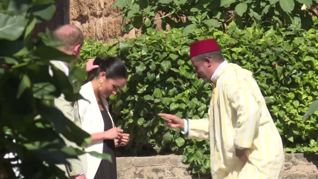 Prince Harry and his wife Meghan Duke Duchess of Sussex meet with local craftsmen during a visit to the Kasbah of the Udayas near the Moroccan...