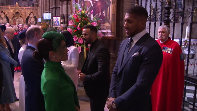 prince harry and meghan chat with anthony joshua after commonwealth day service in westminster abbey their last official duty as working royals - service stock videos & royalty-free footage