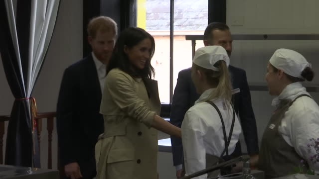 Prince Harry and Meghan Duchess of Sussex greeting chefs on a visit to Charcoal Lane in Melbourne Australia