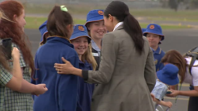 Prince Harry and Meghan Duchess of Sussex greeting children on a visit to Dubbo Australia