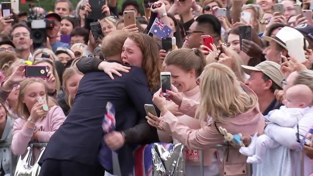 Prince Harry and Meghan Duchess of Sussex greeting fans in Melbourne Australia