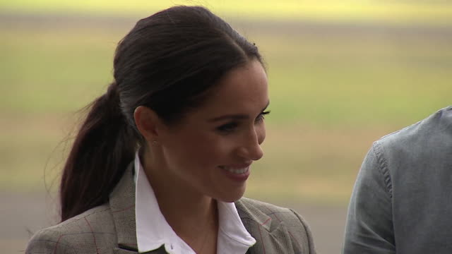 Prince Harry and Meghan Duchess of Sussex joking about the amount of flies on a visit to Dubbo Australia