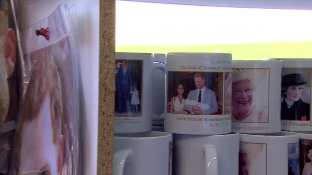 prince harry and meghan duchess of sussex memorabilia in windsor outside the prince harry pub - mug stock videos & royalty-free footage