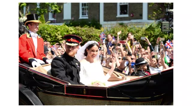 Prince Harry and Meghan Duchess of Sussex ride in the Ascot Landau on procession through Windsor after their marriage at Windsor Castle on May 19...