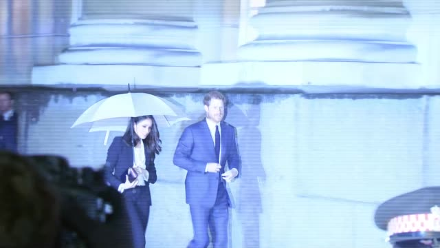 Prince Harry and Meghan Markle attend the Endeavour Fund Awards London Prince Harry and fiancée Meghan Markle along under umbrella as arriving to...