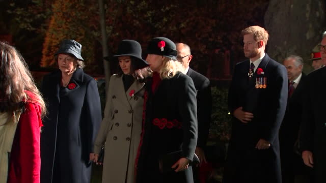 Prince Harry and Meghan Markle attending a memorial service for fallen Australian and New Zealand soldiers at a war memorial in London on ANZAC day