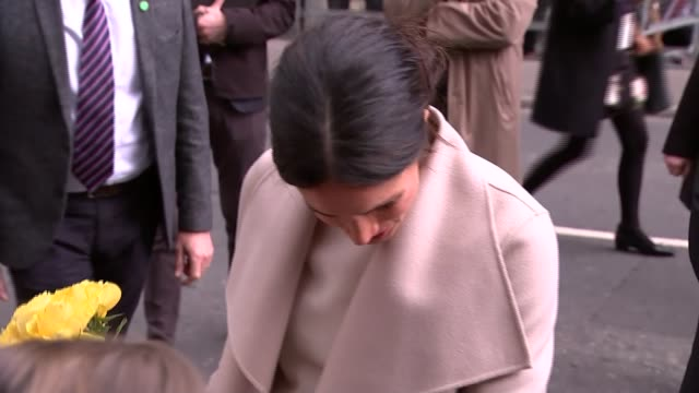 prince harry and meghan markle belfast walkabout northern ireland belfast ext prince harry and meghan markle along meeting public and given flowers... - nordirland stock-videos und b-roll-filmmaterial