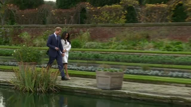 prince harry and meghan markle engagement announced england london kensington palace sunken garden ext prince harry and meghan markle hand in hand... - photo call stock videos & royalty-free footage