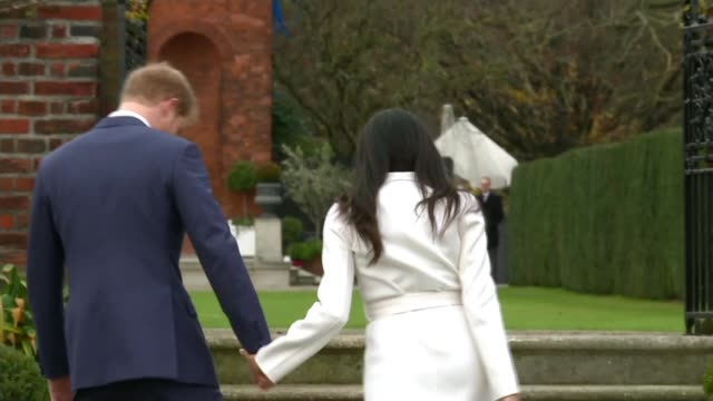 prince harry and meghan markle engagement announced kensington palace sunken garden ext prince harry and meghan markle waving to cameras during... - photo call stock videos & royalty-free footage