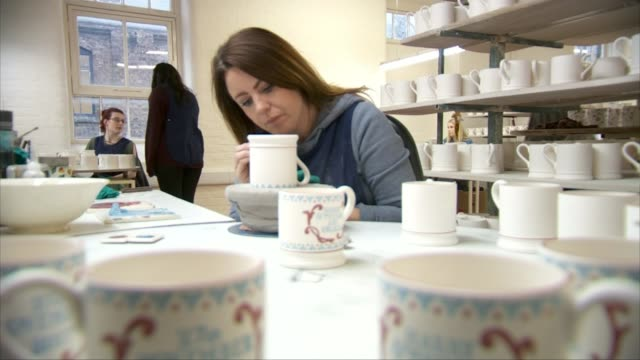 prince harry and meghan markle engagement reaction england emma bridgewater ceramics int close shots of worker stencilling 'harry and meghan are... - souvenir stock videos and b-roll footage
