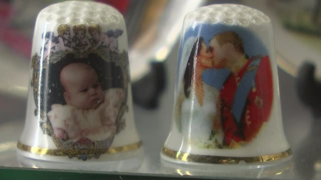 prince harry and meghan markle engagement wedding plans berkshire windsor royal souvenirs on display in shop window queen model thimbles featuring... - souvenir stock videos and b-roll footage