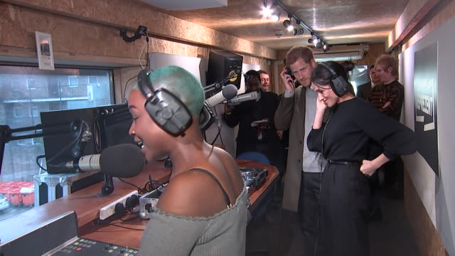 Prince Harry and Meghan Markle listening in to a radio broadcast on an official visit to Reprezent FM