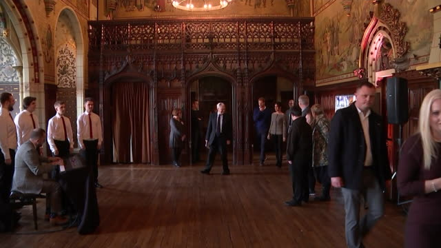 Prince Harry and Meghan Markle listening to a musical performance inside Cardiff Castle
