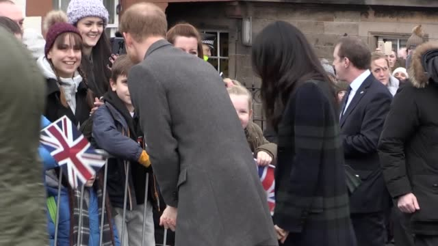 Prince Harry and Meghan Markle meet members of the public outside Edinburgh Castle They also met the regimental mascot of the Argyll and Sutherland...