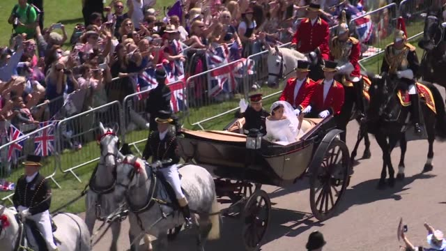prince harry and meghan markle now styled the duke and duchess of sussex enjoy a carriage procession down windsor's long walk after their marriage in... - cocchio video stock e b–roll
