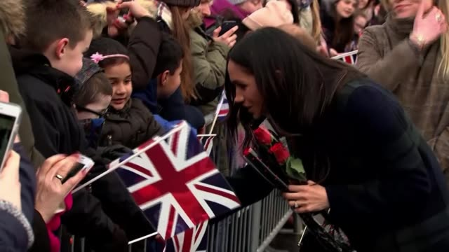 Prince Harry and Meghan Markle on visit to Scotland SCOTLAND Edinburgh INT Meghan Markle meeting crowd of well wishers outside Edinburgh Castle Crowd...