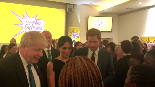 prince harry and meghan markle speak to guests with boris johnson at a women's empowerment reception at the royal aeronautical society in london... - british empire stock videos & royalty-free footage