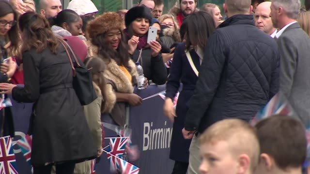 prince harry and meghan markle visit birmingham walkabout at millennium point england west midlands birmingham ext children waving union jack flags /... - birmingham england stock videos & royalty-free footage