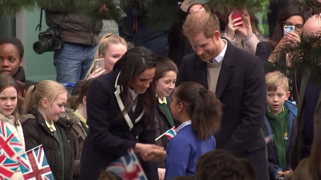 Prince Harry and Meghan Markle visit Birmingham West Midlands Birmingham EXT Meghan Markle shaking hands with Sophia Richards and hugging her as...
