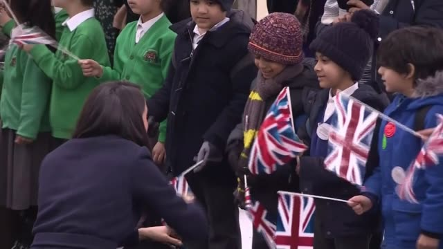 Prince Harry and Meghan Markle visit Birmingham West Midlands Birmingham EXT Meghan Markle shaking hands with young children on walkabout