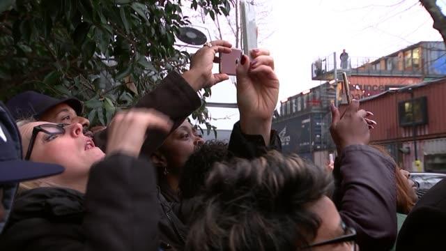 vídeos de stock, filmes e b-roll de prince harry and meghan markle visit community radio station in brixton england london brixton ext sign 'harry megan brixton loves you' on barrier... - brixton
